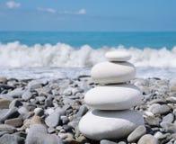 Stone zen-like balance. Balance white stones zen-like on a pebble beach Royalty Free Stock Images