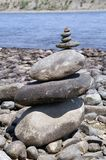 Stone zen tower on a river bank Stock Photos