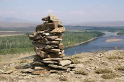 Stone zen tower at the top of a river bank Royalty Free Stock Photography