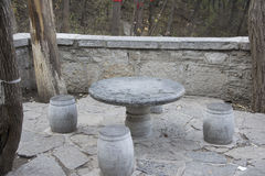 Stone Zhuodeng. A table and stool made of stone on a mountain path Stock Photo