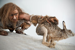 Stoneage Man. Is hunting for a rabbit Royalty Free Stock Photo