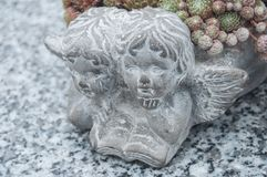 Stoned angel at cemetery Stock Photos