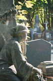 Stoned angel in cemetery. On a tomb Stock Photo