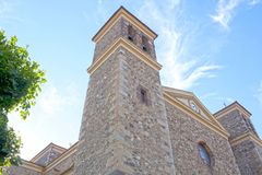 Stoned church of Potes in a cloudless day. San Vicente in Spain Stock Images