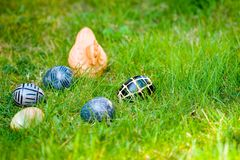 Stoned eggs and stoned chicken Royalty Free Stock Image