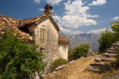 Stoned house mediterranean landscape. Picturesque old house with red roof in beautiful mountains nature, architecture background Royalty Free Stock Image