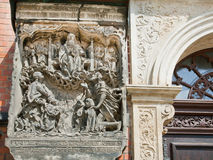 Stoned image of God, Adam and Eve on the wall the old church Royalty Free Stock Images