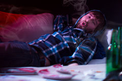 Stoned man lying on couch. Stoned man is lying on couch at home Stock Images