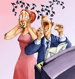 Stoned. A man plays the piano and sings singing as he stunts as a woman stays in the ears Stock Images