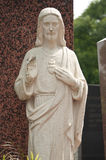 Stoned statue of a christ. Stoned angel  statue in cemetery Royalty Free Stock Image