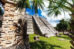 Stoned wall and Chichen Itza monument, Mexico Royalty Free Stock Image