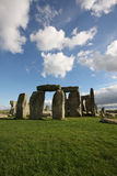 Stonehenge. On a bright summer afternoon with white clouds stock image