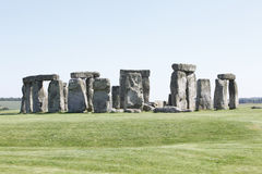 Stonehenge. On Salisbury Plain, Wiltshire, England with clear blue sky and green grass. It's the world famous prehistoric landmark and World Heritage Site royalty free stock image