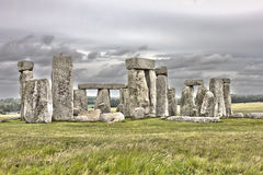 The Stonehenge. The famous Stonehenge with a dramatic sky royalty free stock photos