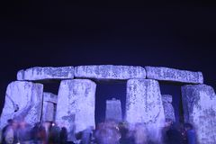 Stonehenge. At night on the summer solstice with worshippers royalty free stock photos