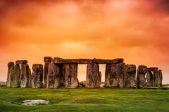 Stonehenge. Against fiery orange sunset sky Royalty Free Stock Photo
