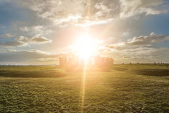 Stonehenge against the sun, Wiltshire, England Stock Photo