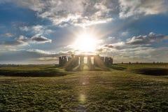 Stonehenge against the sun, Wiltshire, England. Stonehenge against the sun with reflections, Wiltshire, England stock images