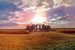 Stonehenge against the sun, Wiltshire, England. Stonehenge against the sun with reflections, Wiltshire, England stock photos