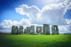 Stonehenge an ancient prehistoric stone monument on blue sky in. Wiltshire, UK stock photos