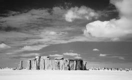 Stonehenge. A black and white photo of Stonehenge and tourists visiting it royalty free stock image