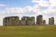 Stonehenge with Clouds - England. You can see the mounds of earth that were around Stonehenge in this shot. There was originally a ditch all the way around Royalty Free Stock Photos