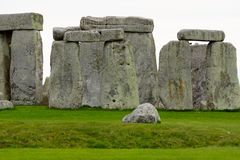 Stonehenge On A Cloudy Day. During the springtime with bright green grass stock photography