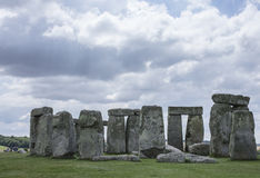 Stonehenge - cloudy skies and green meadows. This image shows Stonehenge is a prehistoric monument in Wiltshire, England, 2 miles west of Amesbury and 8 miles stock image
