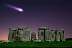 Stonehenge and comet is a megalithic monument Neolithic. Stonehenge and comet, comes to mind the image of a stone circle that rises, alone, on the green grass of stock image