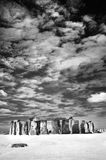 Stonehenge with dramatic sky. Stonehenge, a prehistoric site with standing stones, situated in Southern England recorded using black and white infrared film (or royalty free stock image