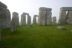 Stonehenge in early morning. A view of the standing stones at Stonehenge in England on a foggy morning Stock Image