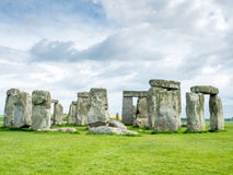 Stonehenge in England. Stonehenge an ancient prehistoric stone monument near Salisbury, Wiltshire, England, with unrecognized tourist nearby. Stonehenge is the royalty free stock photography
