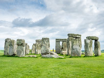 Stonehenge in England. Stonehenge an ancient prehistoric stone monument near Salisbury, Wiltshire, England, with unrecognized tourist nearby. Stonehenge is the royalty free stock photos
