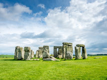 Stonehenge in England. Stonehenge an ancient prehistoric stone monument near Salisbury, Wiltshire, England, with unrecognized tourist nearby. Stonehenge is the royalty free stock images