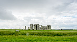 Stonehenge in England. Stonehenge an ancient prehistoric stone monument near Salisbury, Wiltshire, England, with unrecognized tourist nearby. Stonehenge is the stock photo