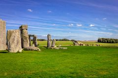 Stonehenge in England. Stonehenge is a prehistoric monument in Wiltshire in England. It consists of a ring of standing stones stock image