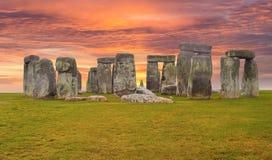 Stonehenge England Sunset Sky. Historic and Famous Stonehenge circle rock formation and colorful yellow, orange sunset sky royalty free stock image