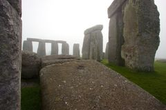 Stonehenge on a foggy morning. A view of Stonehenge from within the standing stones Stock Photography