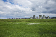 Stonehenge - green meadows and cloudy skies. This image shows Stonehenge is a prehistoric monument in Wiltshire, England, 2 miles west of Amesbury and 8 miles royalty free stock photography