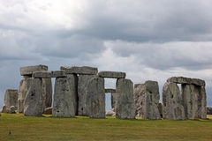Stonehenge historic site on green grass under blue sky. Stonehen Stock Image