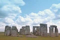 Stonehenge historic site on green grass under blue sky. Stonehen Stock Photos
