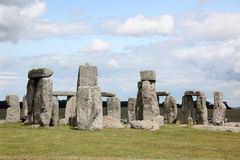 Stonehenge historic site on green grass under blue sky. Stonehen Stock Photos