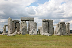 Stonehenge historic site on green grass under blue sky. Stonehen Stock Images