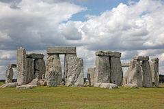 Stonehenge historic site on green grass under blue sky. Stonehen Royalty Free Stock Photo