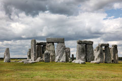 Stonehenge historic site on green grass under blue sky. Stonehen Royalty Free Stock Photos