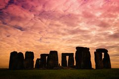 Stonehenge, one of the wonders of the world and the best-known prehistoric monument in Europe, located in Wiltshire, England. UK. Stone silhouettes at sunset stock photo