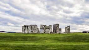 Stonehenge prehistoric monument, green grass, clouds, panoramic view - Wiltshire, Salisbury, England stock image