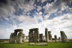 Stonehenge. Is a prehistoric monument in Wiltshire, England, 2 miles 3 km west of Amesbury and 8 miles 13 km north of Salisbury. It consists of a ring of stock images