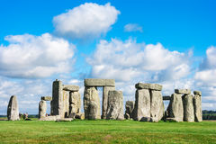 Stonehenge, Salisbury Plain, Wiltshire, UK. Blue sky with white fluffy clouds over the massive circle of stones that make up the world famous prehistoric stock images