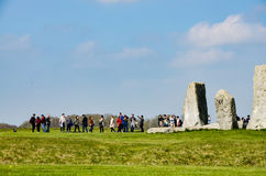 Stonehenge, tourists, green grassland, sunny, Wiltshire, England stock photography